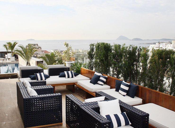 Cobertura | Hotel Royal Rio Palace TRIDI arquitetura Varandas, alpendres e terraços modernos