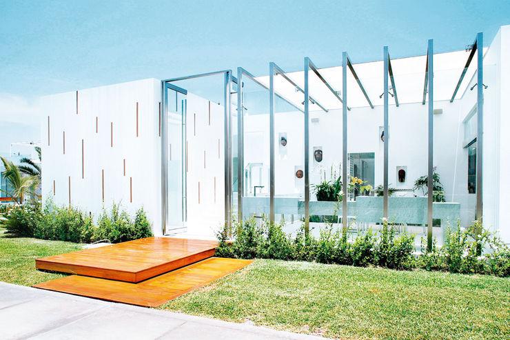 CASA DE PLAYA M.M. Karím Chaman Arquitectos Casas modernas: Ideas, diseños y decoración