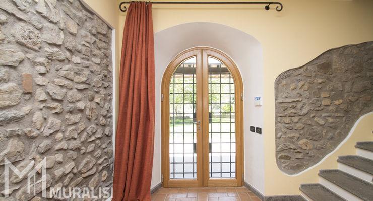 Porta finestra ad arco Muralisi, infissi dal 1987 Finestre in legno Legno Effetto legno