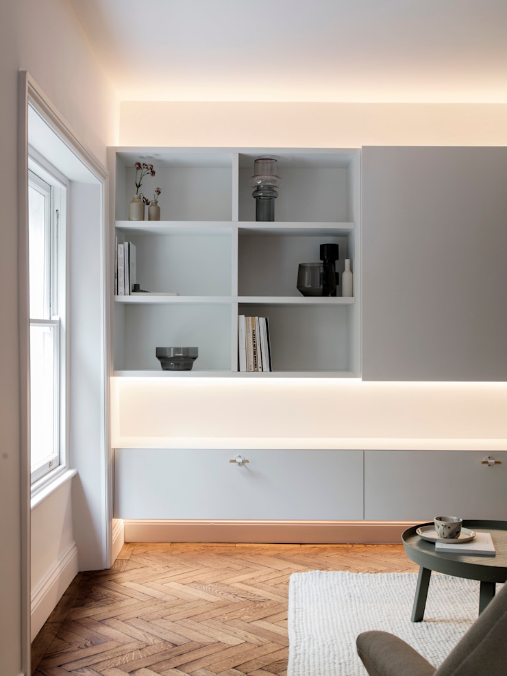 Living room - Media unit (lights on) Brosh Architects Modern Living Room Wood White