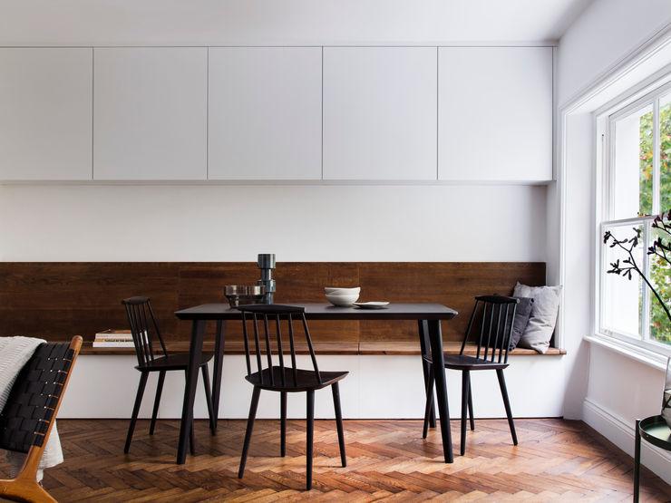 Dining room (lights off) Brosh Architects Modern Living Room Wood White