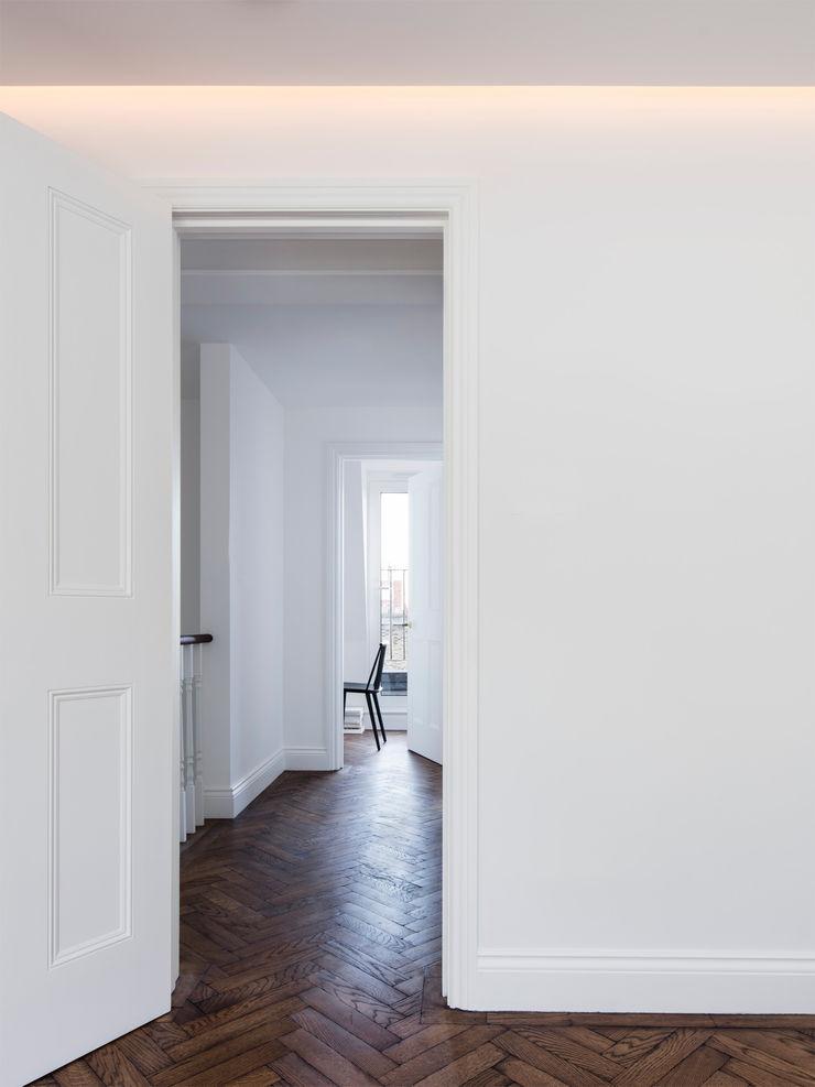 Landing - upper level Brosh Architects Modern Corridor, Hallway and Staircase White