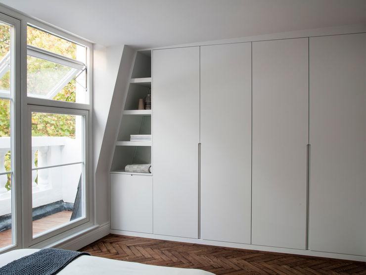 Master bedroom Brosh Architects Modern Bedroom MDF White