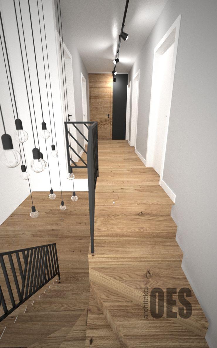 OES architekci Pasillos, vestíbulos y escaleras minimalistas Madera Negro