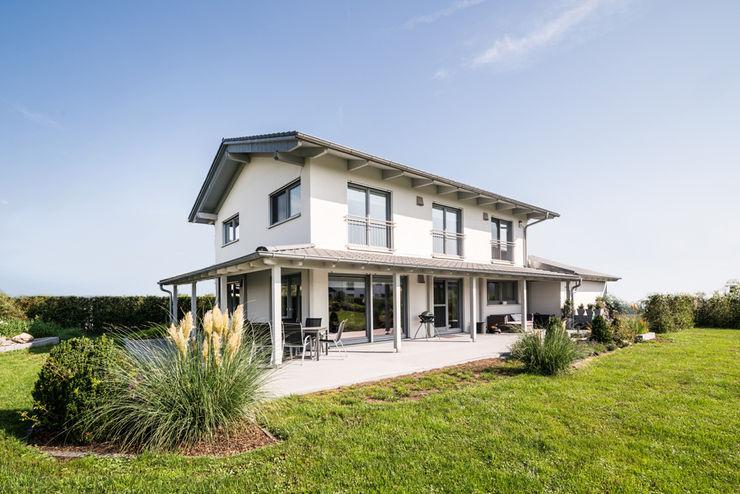 Ausgefallene Stadtvilla mit mediterranem Flair wir leben haus - Bauunternehmen in Bayern Einfamilienhaus