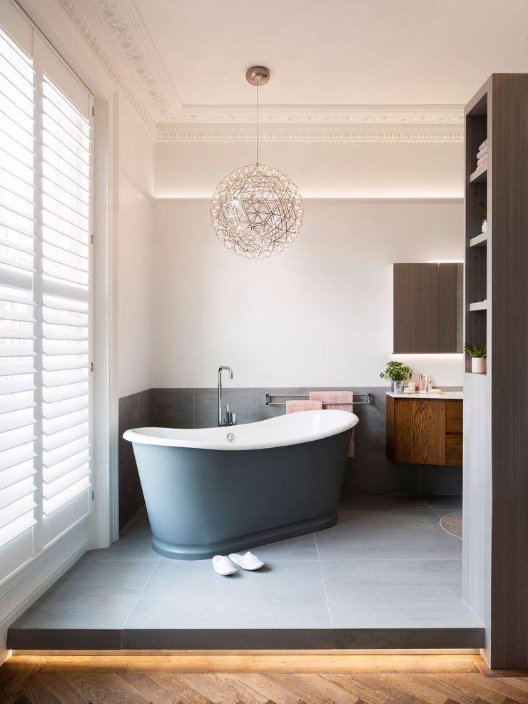Master bathroom - lights on Brosh Architects Modern Bathroom