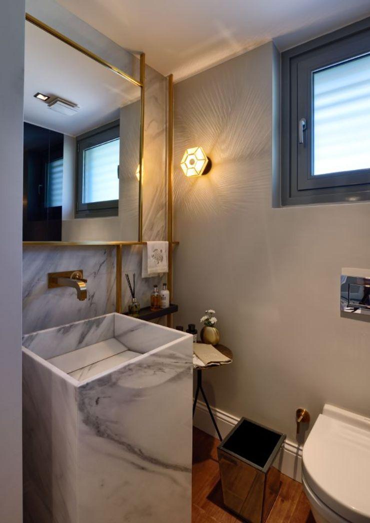 ABA HOUSE Esra Kazmirci Mimarlik Modern bathroom Limestone White
