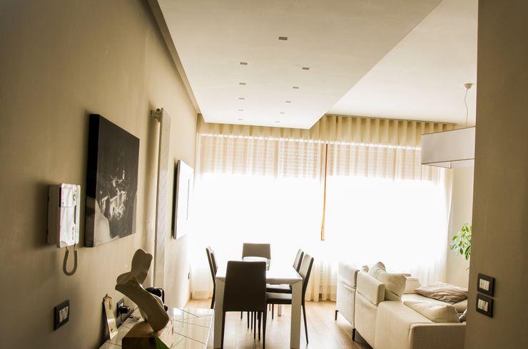 Calore e Design Studio ARCH+D Soggiorno moderno