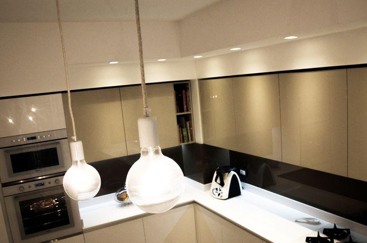 Calore e Design Studio ARCH+D Cucina moderna