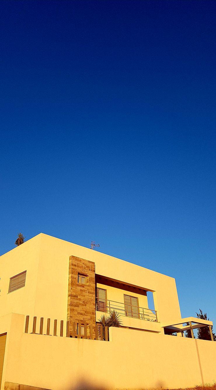 FACHADA Y PAISAJE Mohedano Estudio de Arquitectura S.L.P. Casas unifamilares