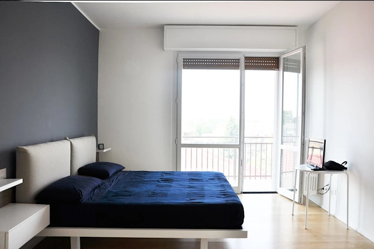 Appartamento in città atelier architettura Camera da letto moderna