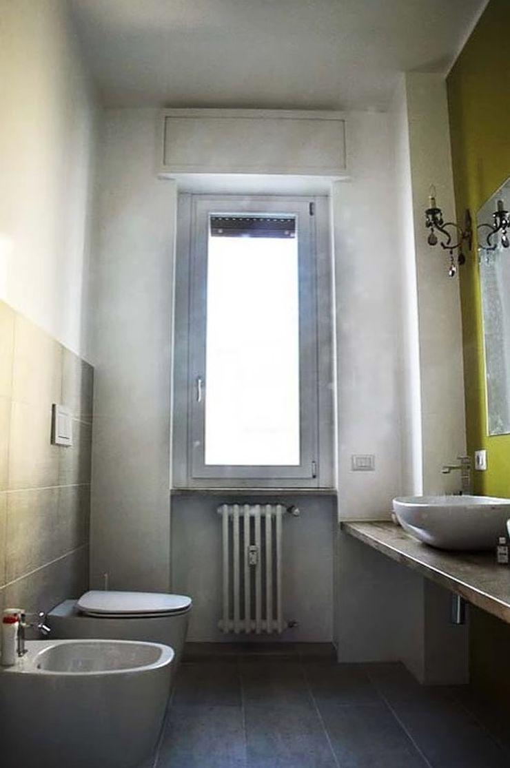 Appartamento in città atelier architettura Bagno moderno