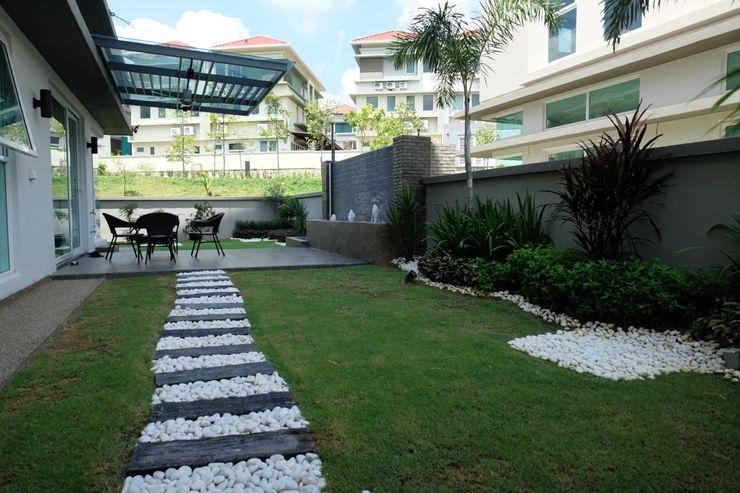 inDfinity Design (M) SDN BHD Jardines de estilo tropical