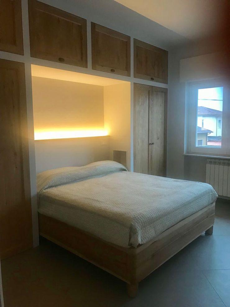 Armadiatura Falegnameria Martinelli Sergio Camera da letto coloniale Legno Trasparente