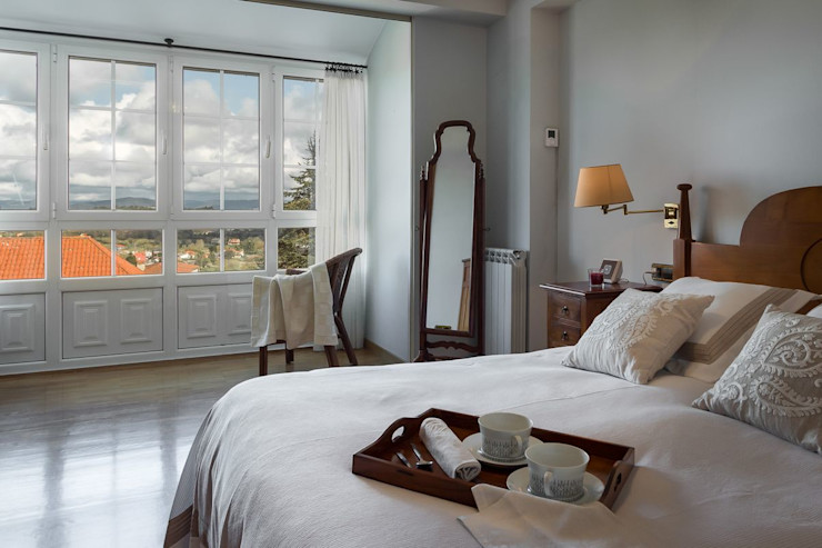 MORANDO INMOBILIARIA Rustic style bedroom