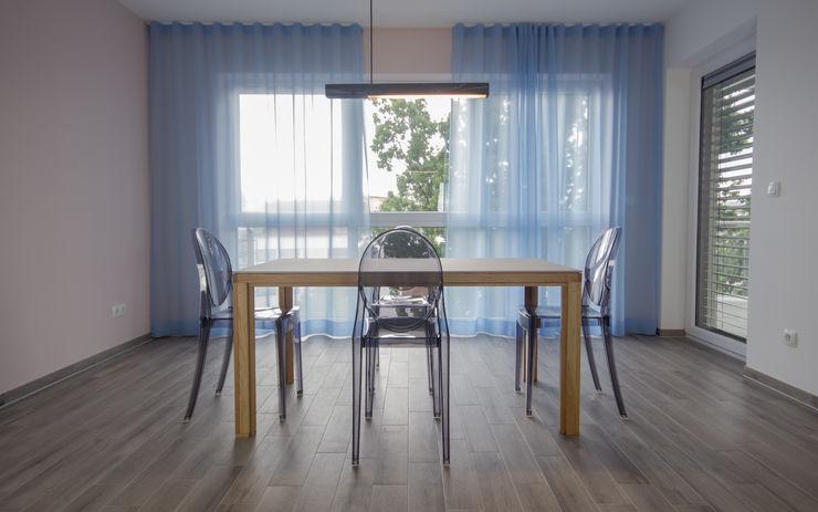 Esszimmerplanung und -gestaltung BANDYOPADHYAY interior Moderne Esszimmer