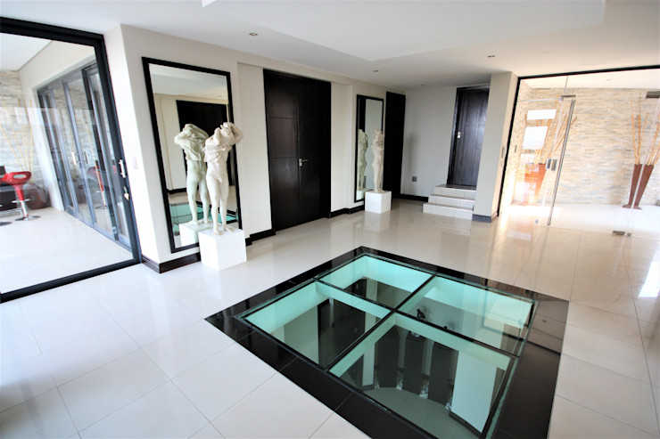 Foyer looking at front door. Nuclei Lifestyle Design Modern Corridor, Hallway and Staircase Black