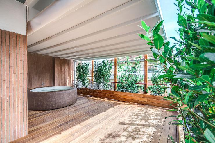 ISIDORO MOB ARCHITECTS Piscina moderna