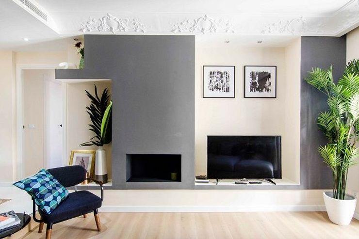 Chimenea de la Vivienda de Pedro Rez estudio Salones de estilo moderno Madera Gris