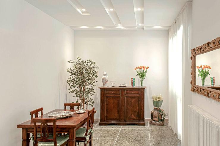 Soggiorno - sala da pranzo Luca Bucciantini Architettura d' interni Soggiorno minimalista Bianco