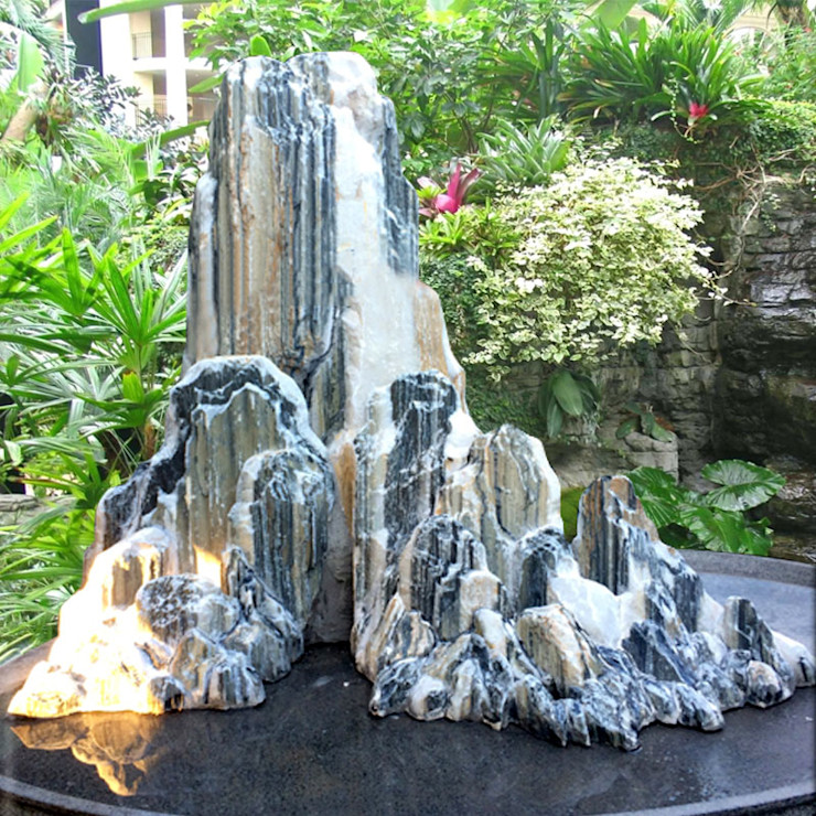 Hòn non bộ bằng đá tuyết sơn mini Công Ty Thi Công Và Thiết Kế Tiểu Cảnh Non Bộ