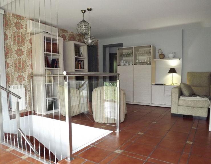Salón después Almudena Madrid Interiorismo, diseño y decoración de interiores Salas de estilo clásico