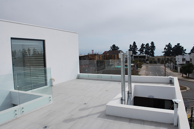 DARQ studio Balcones y terrazas modernos
