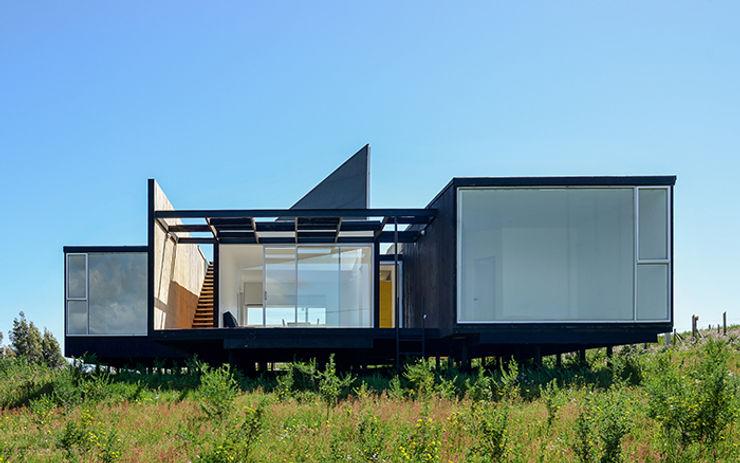 Fachada Oriente mutarestudio Arquitectura Casas estilo moderno: ideas, arquitectura e imágenes