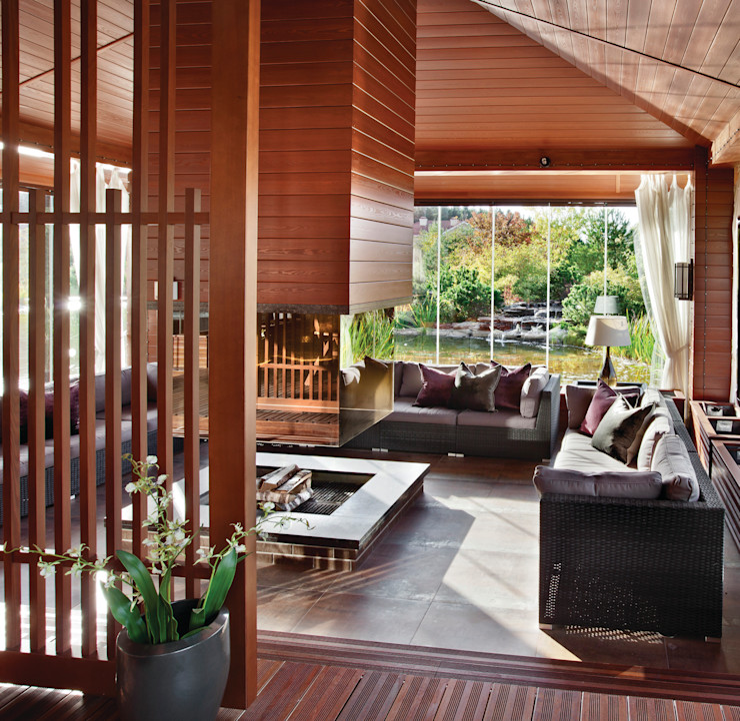 Зона барбекю с подогреваемой гранитной столешницей. AMG project Балконы и веранды в эклектичном стиле