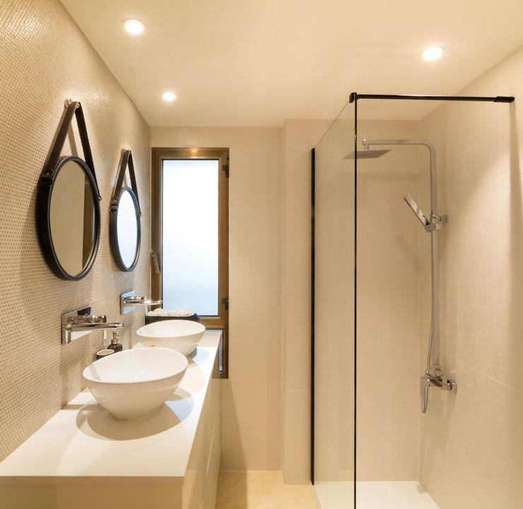 Baño del dormitorio principal homify Baños de estilo ecléctico Mármol Beige