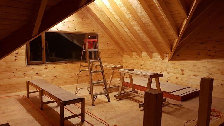 Construcción de Casa de madera en Pucón, Chile. Patagonia Log Homes - Arquitectos - Neuquén Techos a dos aguas Madera Acabado en madera