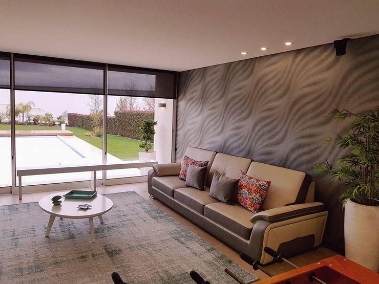 Remodelação Moradia de Luxo em Barcelos Atelier Kátia Koelho Salas de estar modernas