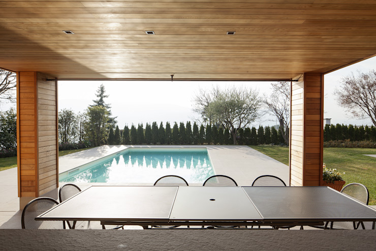 GIARDINO Studio Architettura Macchi Giardino con piscina Pietra Beige