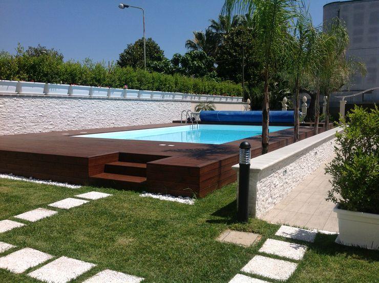 Relax sull'uscio di casa Blu Design srl Giardino con piscina