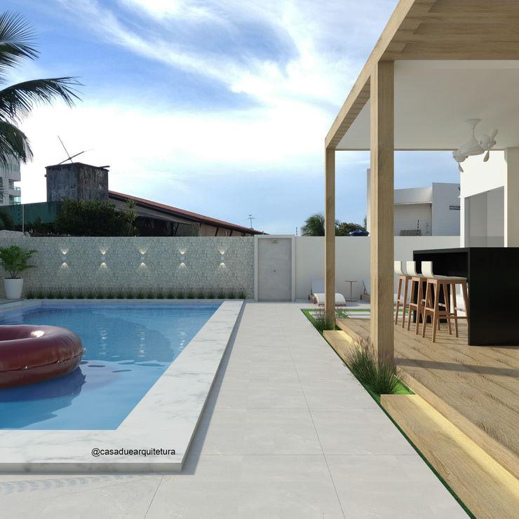 CASA DUE ARQUITETURA Rustic style pool