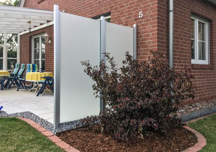 ZAUN-AUS-GLAS - Realisierte Projekte - Glaszaun als Trennwand als Sichtschutz ZAUN-AUS-GLAS Moderner Garten Glas