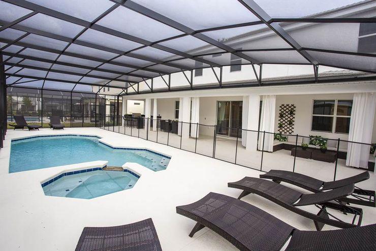 Espaço da piscina Flávia Gueiros Piscinas de jardim Azul