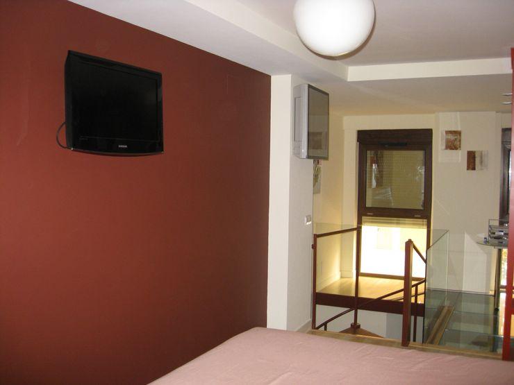 Dormitorio Almudena Madrid Interiorismo, diseño y decoración de interiores Dormitorios de estilo industrial
