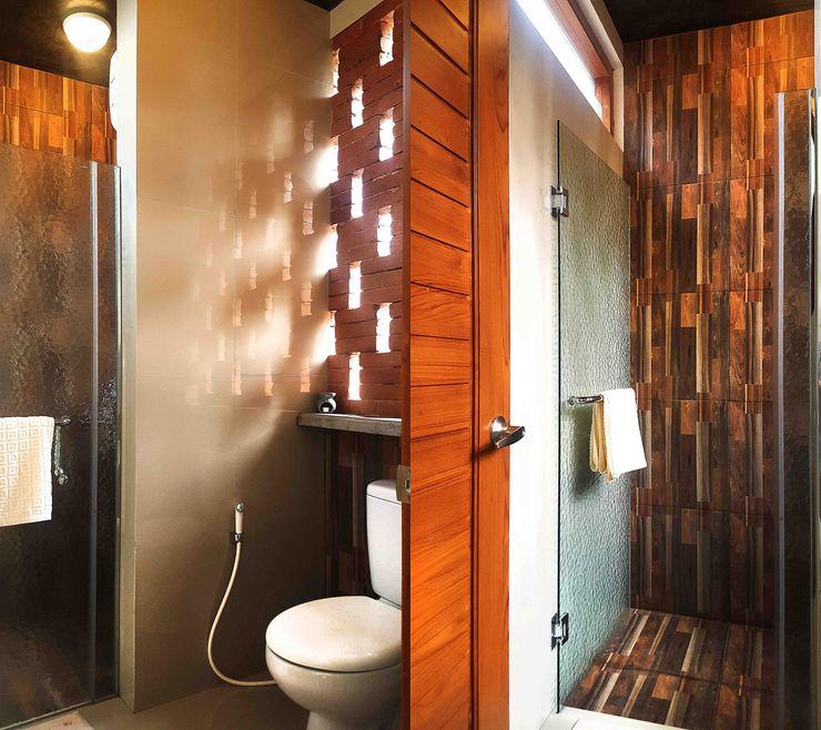 Mandalananta Studio Baños de estilo tropical Ladrillos Ámbar/Dorado