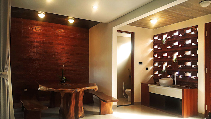 Mandalananta Studio Tropical style dining room Bricks Amber/Gold