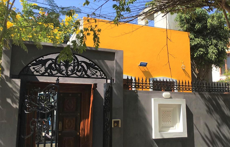Rima and Devaiah's Residence Sandarbh Design Studio Eclectic style houses