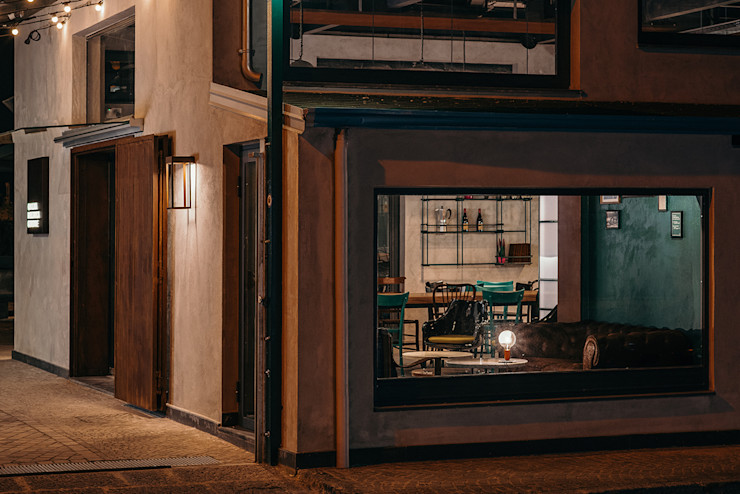 Vetrina lounge manuarino architettura design comunicazione Bar & Club in stile industrial Cemento Grigio