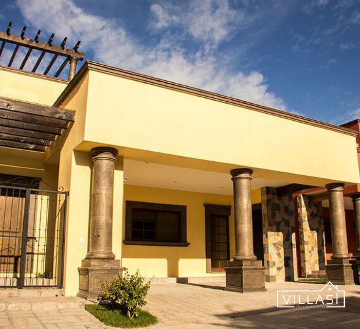 Fachada VillaSi Construcciones Casas rústicas