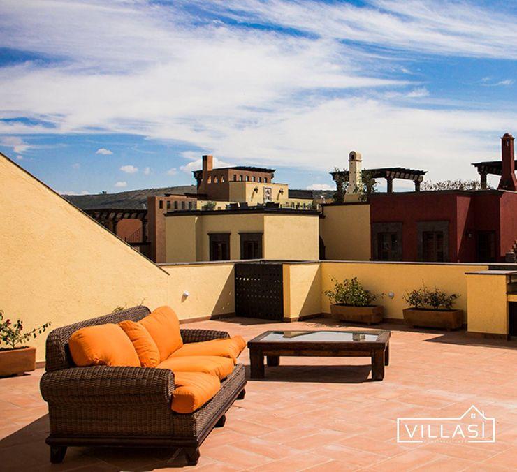 Tercer piso VillaSi Construcciones Balcones y terrazas rústicos