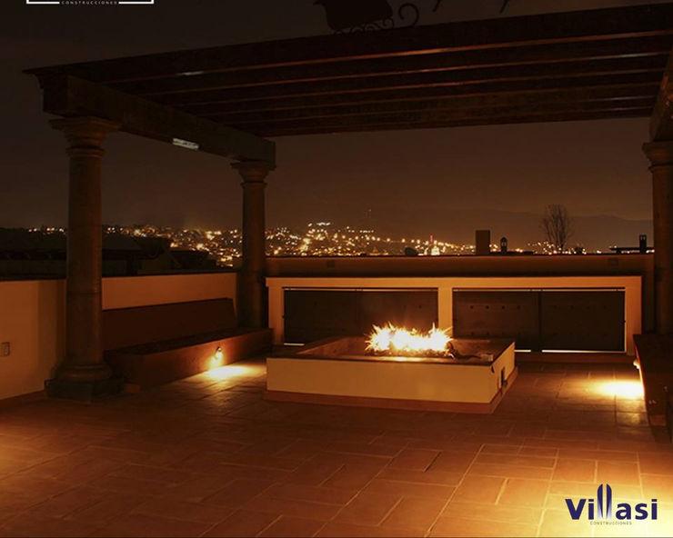 VillaSi Construcciones ラスティックデザインの テラス