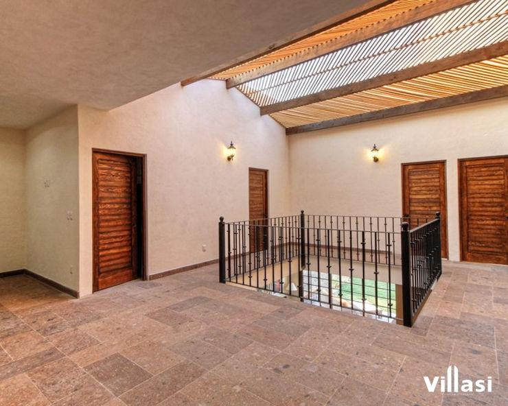 Casa Cantera en San Miguel de Allende VillaSi Construcciones Pasillos, vestíbulos y escaleras rústicos