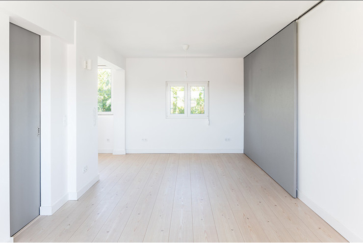 Projeto de Arquitetura Commerzn - Boutique Property Developer Salas de estar minimalistas Madeira Branco