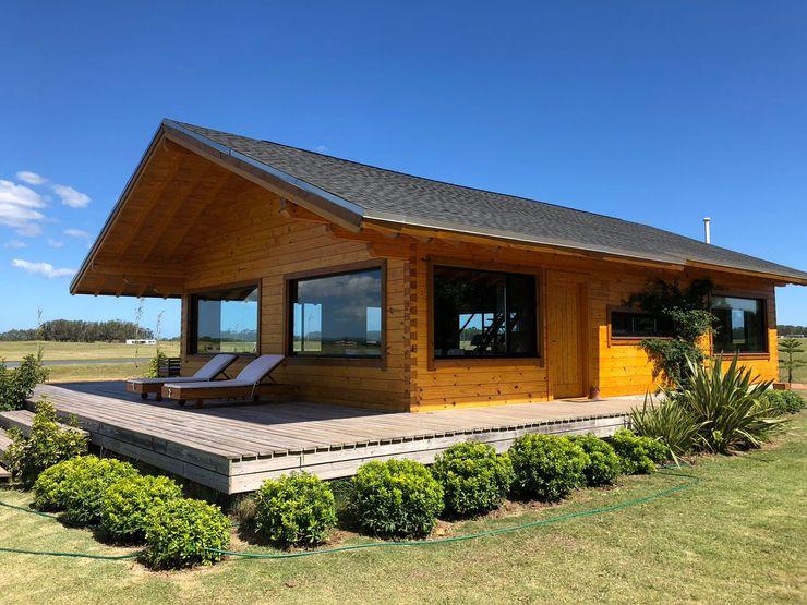 Fachada Patagonia Log Homes - Arquitectos - Neuquén Casas unifamiliares