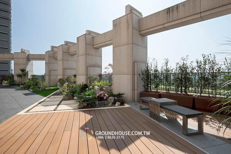 平坦又寬敞的空間除了運動以外也能當作聚會的好地方 大地工房景觀公司 Tropical style balcony, veranda & terrace