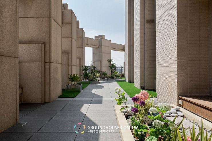 施工前與大樓管委會有密切溝通並符合建築結構法規 大地工房景觀公司 Tropical style balcony, veranda & terrace